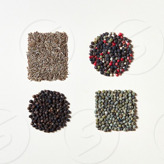 Geometric food set of aromatic spices for the preparation of natural organic home food. Food and cuisine ingredients on a white with copy space. Flat lay photo