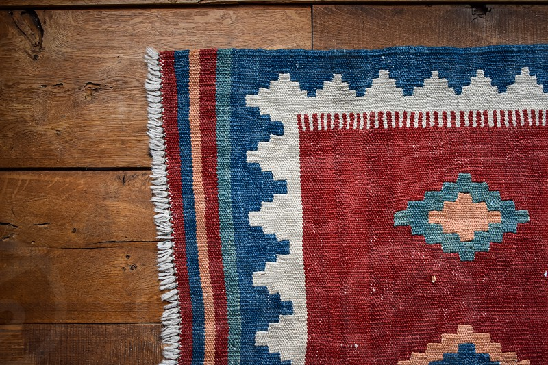 Woven rug on old timber floor  photo