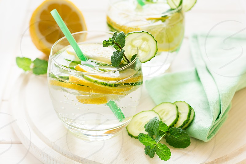 detox with lemon and cucumber decorated mint leaves photo