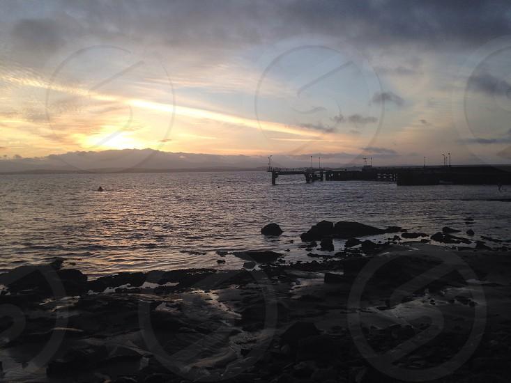Sunrise by a pier on islay photo