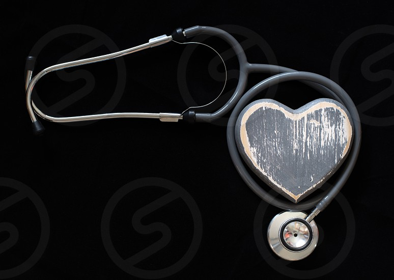 A stethoscope and hand-crafted heart symbolise fitness good health and a healthy lifestyle. photo