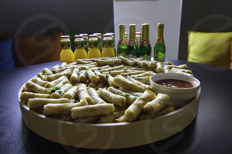 Spring rolls with sauce and drinks photo