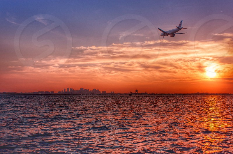 sunset view and airplane on the air photo