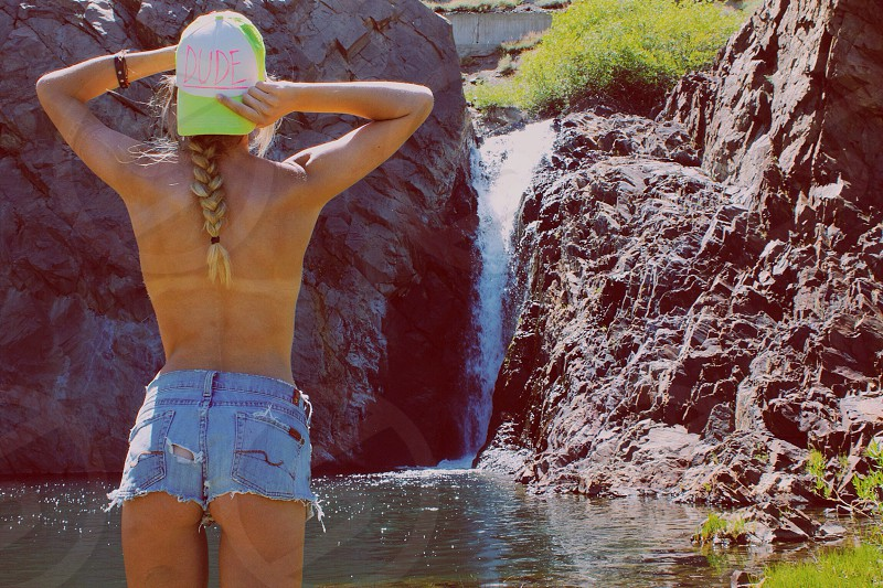 woman near waterfall photo