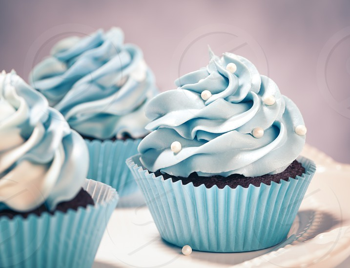 Blue Cupcakes on a plate. Vintage style. photo