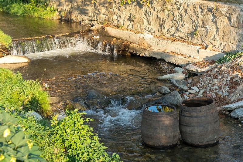 SIBIEL TRANSYLVANIA/ROMANIA - SEPTEMBER 17 : Wooden barrels in the river at Sibiel Transylvania Romania on September 17 2018 photo