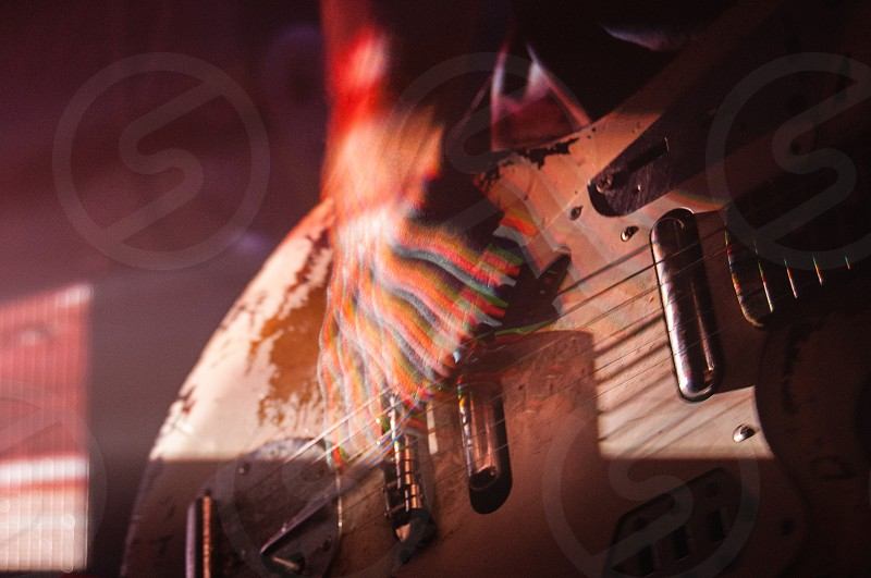 zoom view of brown electric guitar photo