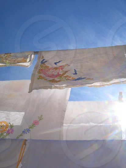 Vintage textiles drying in the sun photo