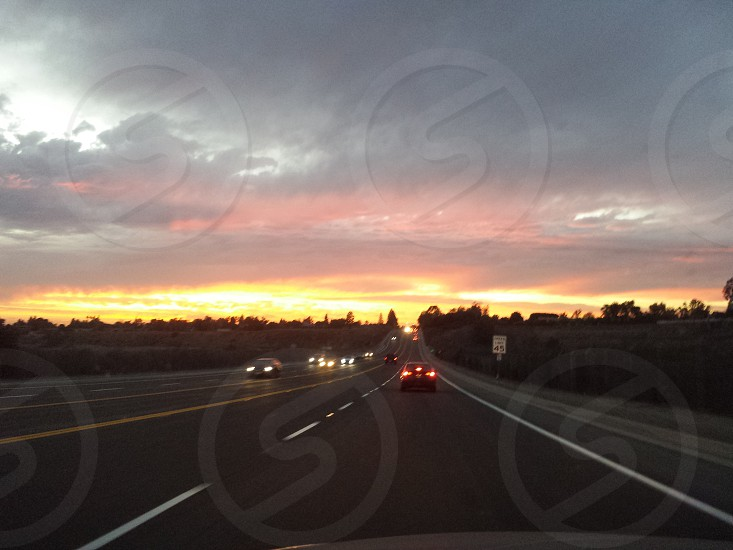 Driving into the sunset at dusk photo