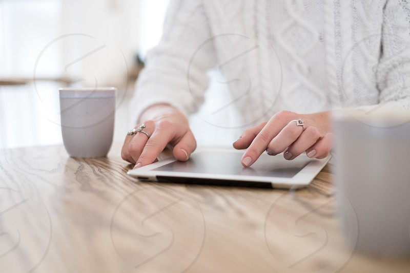 woman using tablet in the cafe photo