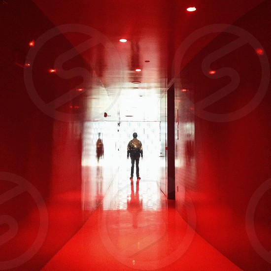 person standing in hallway photo