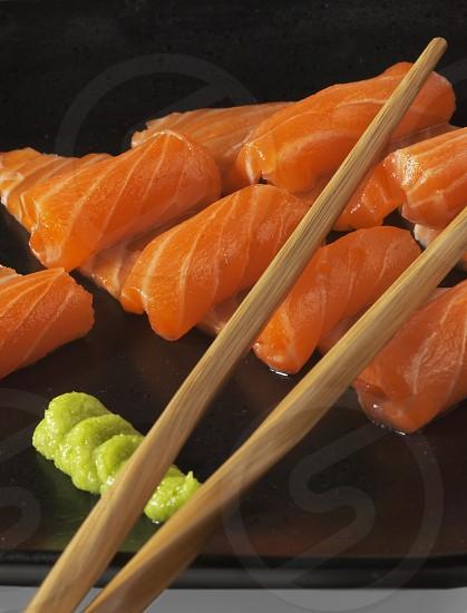slice of salmon sushi with wasabi sauce photo