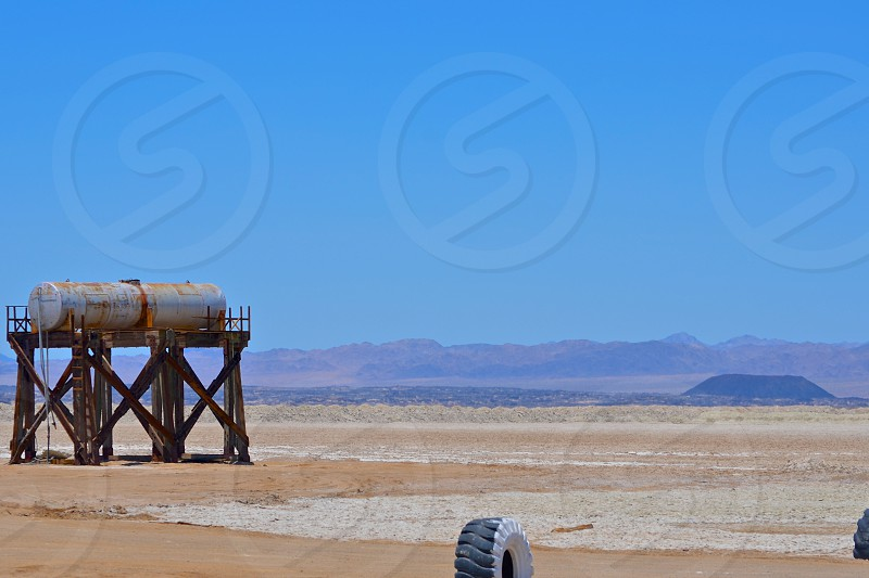 Watertank in the desert.  Windmill land waiting to be improved upon. photo