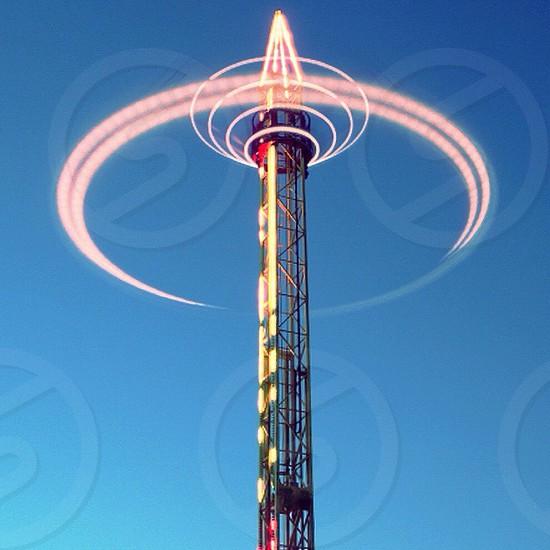 black tower with circular light photo