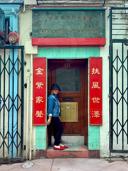 Woman doorway Chinatown  photo