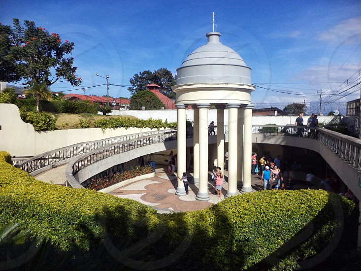 people walking near white concrete dome photo
