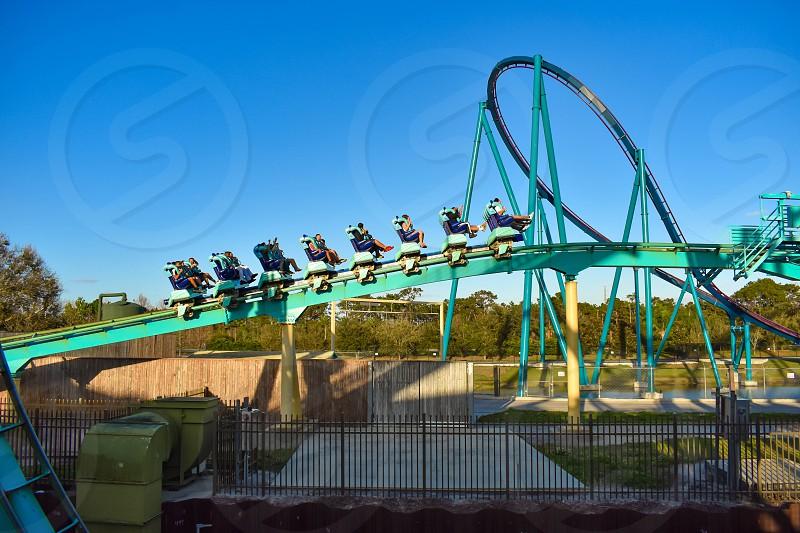 Orlando Florida . February 26  2019.  People enjoying terrific Kraken rollercoaster at Seaworld Theme Park (9) photo
