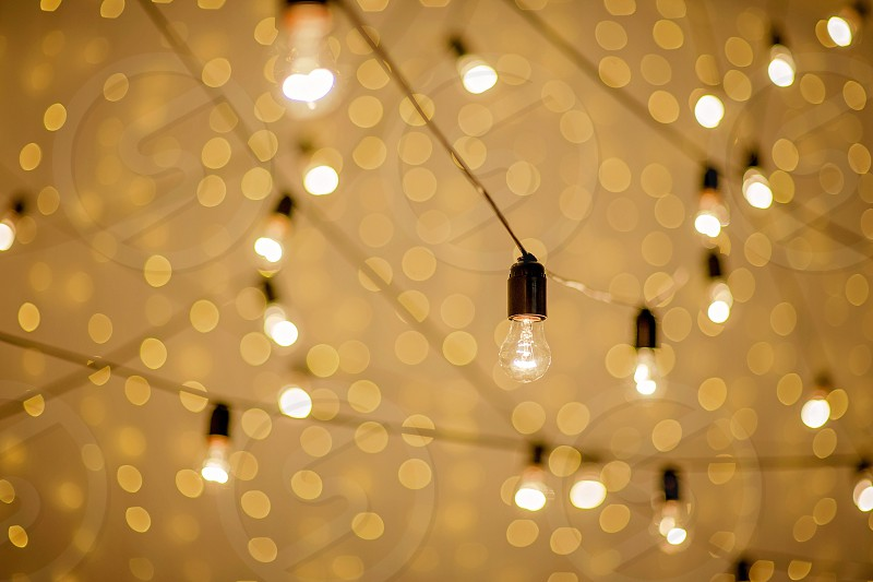 festive garland of electric retro lamps for a birthday party. Happy New Year and Merry Christmas. photo