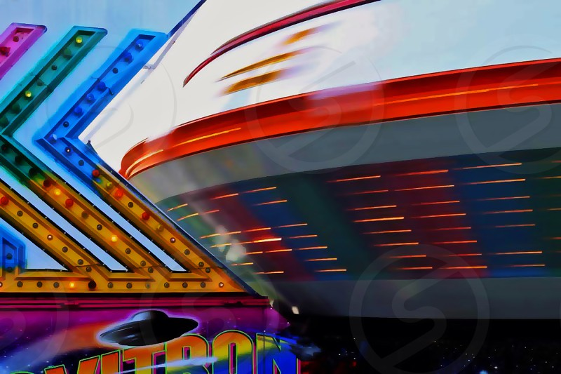 Carnival spaceship motion summer childhood dizzy spin gravitron gravity photo