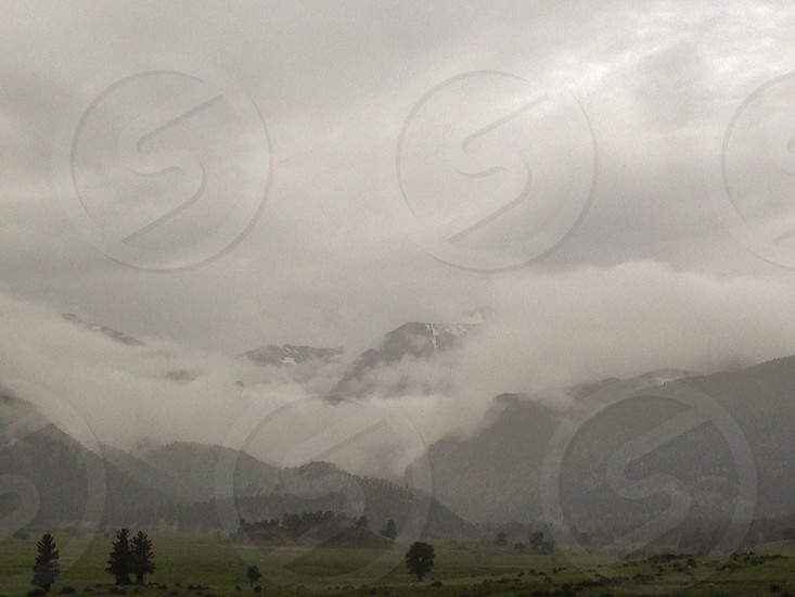 Colorado Rocky Mountains Rocky Mountain National Park mountain clouds mist rain storm nature wilderness field trees forest snow countryside  photo