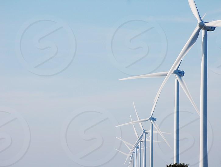 wind turbines under clear blue sky photo