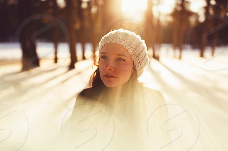 woman in white beanie photo
