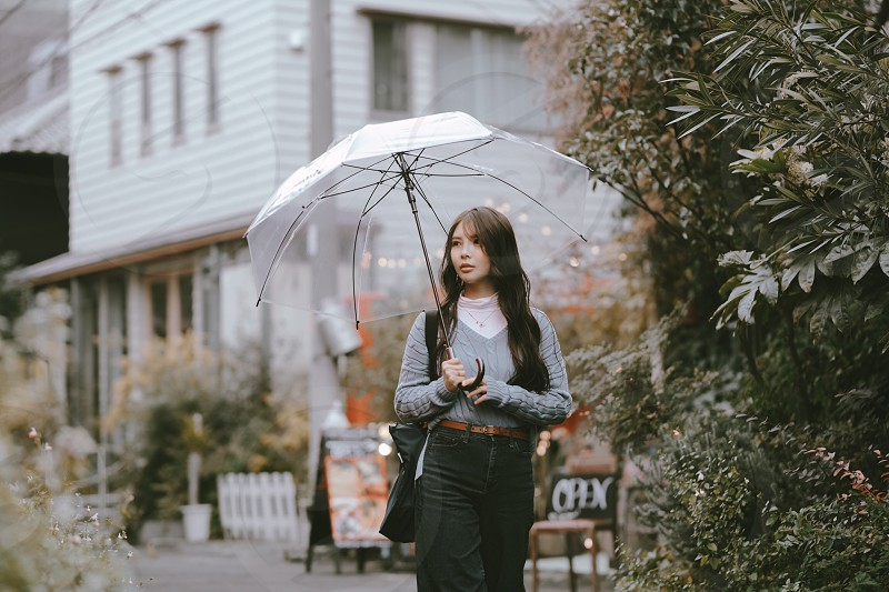 Rainy Day lifestyle girl umbrella lost long hair finding blue photo