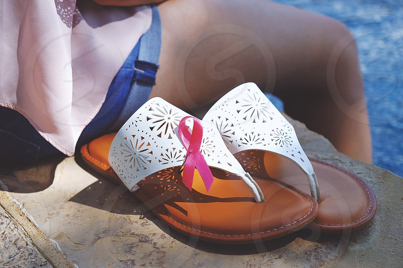 Breast cancer awareness ribbon worn on sandals photo