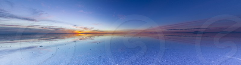 Uyuni reflections are one of the most amazing things that a photographer can see. Here we can see how the sunrise over an infinite horizon with the Uyuni salt flats making a wonderful mirror. Uyuni Bolivia  photo