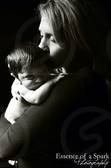 woman carrying baby with text overlay photo