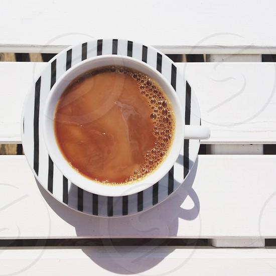 black and white striped ceramic tea cup with liquid photo