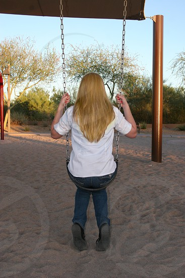 Blond Girl on swing  photo