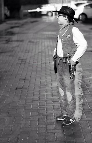 man in cowboy uniform standing  photo