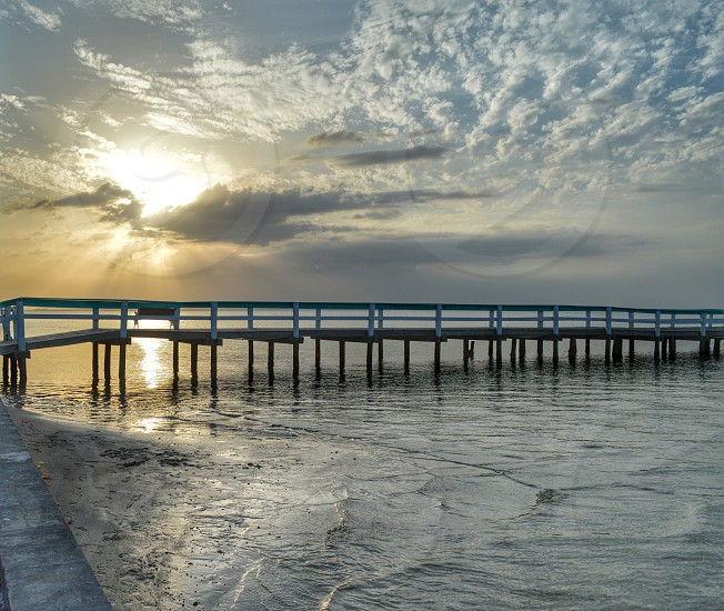 Sunset bokeelia Florida water pier clouds sky sun fishing dock wall tide waves wood coastal photo