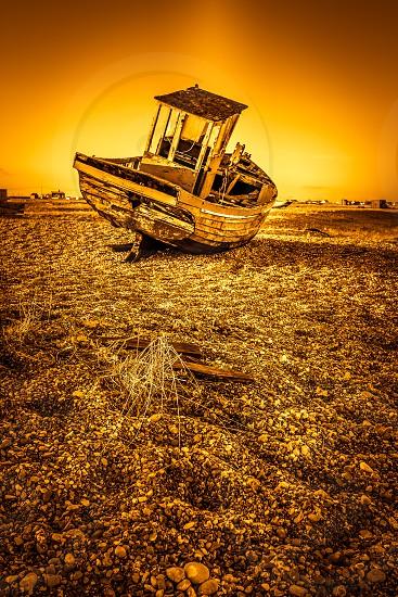DUNGENESS KENT/UK _ DECEMBER 17 :  Derelict Fishing Boat on Dungeness Beach in Kent on December 17 2008 photo