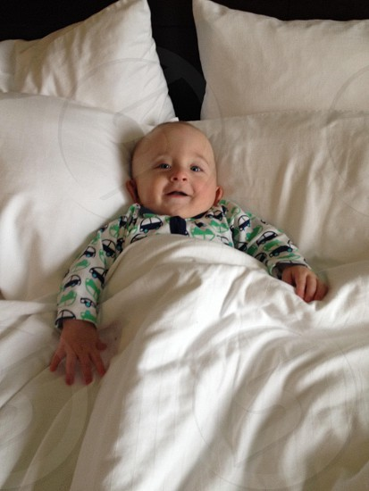 Baby hotel bed photo