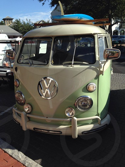 green and white volkswagen bus in parking lot photo