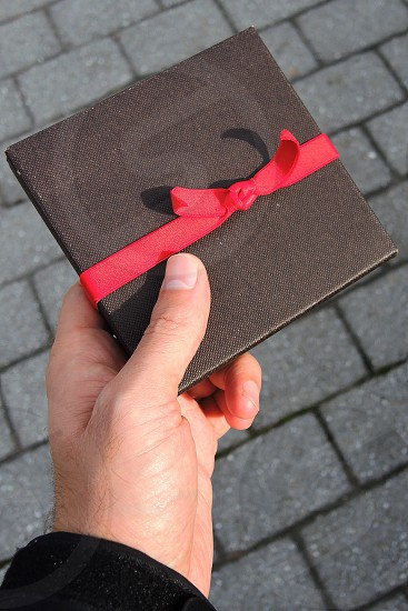 black box with red ribbon photo
