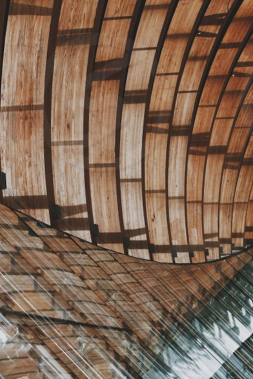 The blending between wood and glass is always an interesting mixture when it comes to architecture. photo