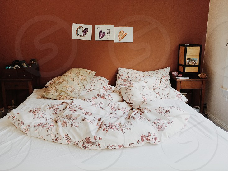view of white with floral design bed sheet photo