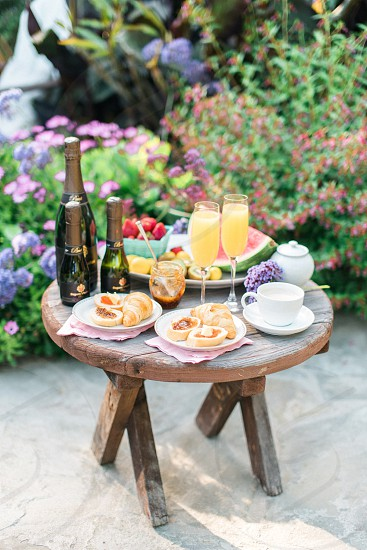 A mimosa brunch with pastries fruit and coffee. photo