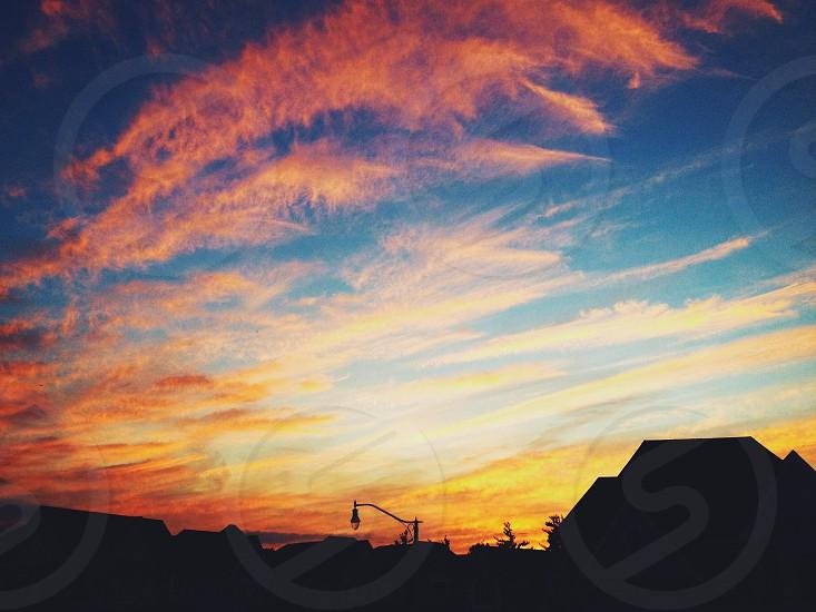 blue skies with orange sunset photo