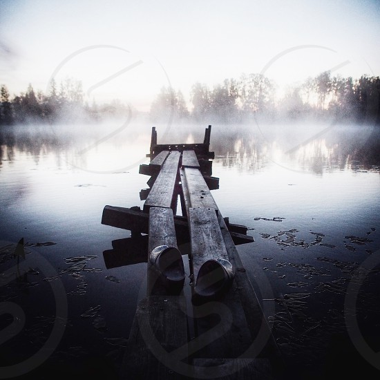 Clogs on a jetty... River water morning misty mist fog foggy pier planks Sweden shoes photo