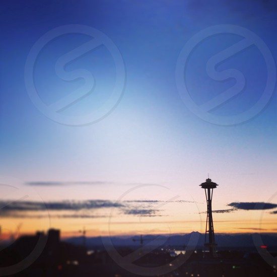 silhouette of space needle tower during sunset photo