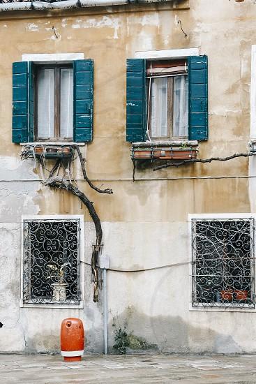 venice italy building facade stone brick yellow ochre windows shutters patina  photo
