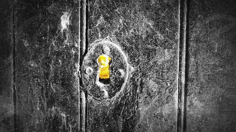 grayscale photo of keyhole photo
