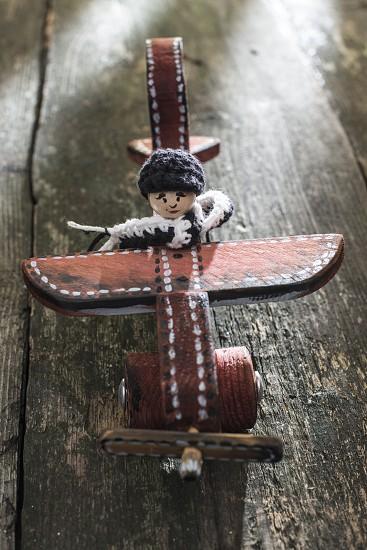 Vintage wooden plane on wooden board. Sunshine through the window photo