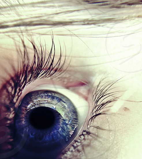 This is my favorite shot I've ever taken of my eye; the title is A Lover's Charm. photo