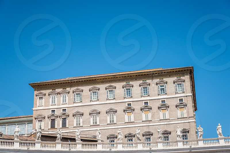 Apostolic Palace in the Vatican from the  Square against blue sky photo