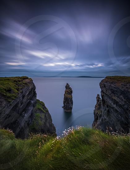 Ireland cliffs ocean sea coast Atlantic county kerry bromore devils castle landscape scenery wild way cliff walk  photo